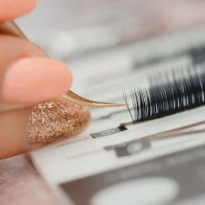 learning how to pick up eyelash extensions from a strip in one of our classic eyelash extensions training courses