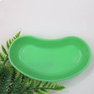 green kidney shaped bowl used for rinsing lash and brow areas on the face
